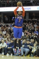Dec 10, 2013; Cleveland, OH, USA; New York Knicks small forward Carmelo Anthony shoots in the fourth quarter against the Cleveland Cavaliers at Quicken Loans Arena. Mandatory Credit: David Richard-USA TODAY Sports