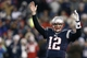 Dec 8, 2013; Foxborough, MA, USA; New England Patriots quarterback Tom Brady (12) signals a touchdown during the fourth quarter of New England's 27-26 win over the Cleveland Browns at Gillette Stadium. Mandatory Credit: Winslow Townson-USA TODAY Sports