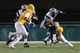 Dec 14, 2013; Hammond, LA, USA; New Hampshire Wildcats wide receiver R.J. Harris (15) is tackled by Southeastern Louisiana Lions linebacker Drew Misita (20) in the first half at Strawberry Stadium. Mandatory Credit: Crystal LoGiudice-USA TODAY Sports