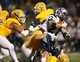 Dec 14, 2013; Hammond, LA, USA; New Hampshire Wildcats running back Nico Steriti (22) is tackled by Southeastern Louisiana Lions linebacker Isaiah Corbett (6) defensive lineman Greg Triay (behind) in the first half at Strawberry Stadium. Mandatory Credit: Crystal LoGiudice-USA TODAY Sports