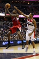 Dec 14, 2013; Washington, DC, USA; Los Angeles Clippers shooting guard Jamal Crawford (11) shoots the ball as Washington Wizards small forward Trevor Ariza (1) defends in the fourth quarter at Verizon Center. Mandatory Credit: Geoff Burke-USA TODAY Sports