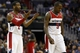 Dec 14, 2013; Washington, DC, USA; Washington Wizards point guard John Wall (2) gestures on the court while Wizards small forward Martell Webster (9) walks away against the Los Angeles Clippers in the third quarter at Verizon Center. The Clippers won 113-97. Mandatory Credit: Geoff Burke-USA TODAY Sports