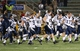 Dec 14, 2013; Hammond, LA, USA; New Hampshire Wildcats run onto the field in celebration after defeating the Southeastern Louisiana Lions 20-17 at Strawberry Stadium. Mandatory Credit: Crystal LoGiudice-USA TODAY Sports