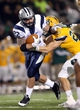 Dec 14, 2013; Hammond, LA, USA; New Hampshire Wildcats running back Nico Steriti (22) fights off Southeastern Louisiana Lions defensive back Tyler Stoddard (23) in the second half at Strawberry Stadium. New Hampshire defeated Southeastern Louisiana 20-17. Mandatory Credit: Crystal LoGiudice-USA TODAY Sports
