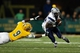 Dec 14, 2013; Hammond, LA, USA; New Hampshire Wildcats wide receiver R.J. Harris (15) carries the ball past Southeastern Louisiana Lions defensive back Denzel Thompson (9) in the second half at Strawberry Stadium. New Hampshire defeated Southeastern Louisiana 20-17. Mandatory Credit: Crystal LoGiudice-USA TODAY Sports