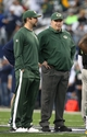 Dec 15, 2013; Arlington, TX, USA; Green Bay Packers head coach Mike McCarthy (right) talks with injured quarterback Aaron Rodgers on the sidelines during the game against the Dallas Cowboys at AT&T Stadium. Mandatory Credit: Matthew Emmons-USA TODAY Sports