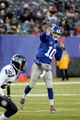 Dec 15, 2013; East Rutherford, NJ, USA; New York Giants quarterback Eli Manning (10) throws a pass against the Seattle Seahawks during the game at MetLife Stadium. Mandatory Credit: Robert Deutsch-USA TODAY Sports