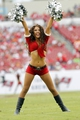 Dec 15, 2013; Tampa, FL, USA; Tampa Bay Buccaneers cheerleader dances during the second half against the San Francisco 49ers at Raymond James Stadium. San Francisco 49ers defeated the Tampa Bay Buccaneers 33-14. Mandatory Credit: Kim Klement-USA TODAY Sports