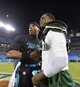 Dec 15, 2013; Charlotte, NC, USA; Carolina Panthers quarterback Cam Newton (1) with New York Jets quarterback Geno Smith (7) after the game. The Panthers defeated the Jets 30-20 at Bank of America Stadium. Mandatory Credit: Bob Donnan-USA TODAY Sports