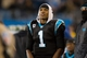 Dec 15, 2013; Charlotte, NC, USA; Carolina Panthers quarterback Cam Newton (1) stands on the sidelines during the fourth quarter against the New York Jets at Bank of America Stadium. Panthers defeated the Jets 30-20. Mandatory Credit: Jeremy Brevard-USA TODAY Sports