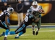 Dec 15, 2013; Charlotte, NC, USA; New York Jets running back Bilal Powell (29) gets tackled by Carolina Panthers outside linebacker Thomas Davis (58) during the fourth quarter at Bank of America Stadium. Panthers defeated the Jets 30-20. Mandatory Credit: Jeremy Brevard-USA TODAY Sports