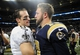 Dec 15, 2013; St. Louis, MO, USA; New Orleans Saints quarterback Drew Brees (9) shakes hands with St. Louis Rams quarterback Kellen Clemens (10) after a game at the Edward Jones Dome. The Rams defeated the Saints 27-16. Mandatory Credit: Jeff Curry-USA TODAY Sports