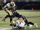 Dec 15, 2013; St. Louis, MO, USA; New Orleans Saints running back Pierre Thomas (23) is tackled by St. Louis Rams cornerback Janoris Jenkins (21) during the second half at the Edward Jones Dome. The Rams defeated the Saints 27-16. Mandatory Credit: Jeff Curry-USA TODAY Sports