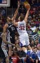 Dec 16, 2013; Los Angeles, CA, USA; Los Angeles Clippers forward Blake Griffin (32) is defended by San Antonio Spurs forward Tim Duncan (21) at Staples Center. The Clippers defeated the Spurs 115-92. Mandatory Credit: Kirby Lee-USA TODAY Sports