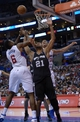Dec 16, 2013; Los Angeles, CA, USA; San Antonio Spurs forward Tim Duncan (21) battles for a rebound with Los Angeles Clippers center DeAndre Jordan (6) and forward Blake Griffin (32) at Staples Center. The Clippers defeated the Spurs 115-92. Mandatory Credit: Kirby Lee-USA TODAY Sports