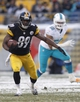 Dec 8, 2013; Pittsburgh, PA, USA; Pittsburgh Steelers wide receiver Jerricho Cotchery (89) runs after a pass reception as Miami Dolphins defensive end Olivier Vernon (50) pursues during the fourth quarter at Heinz Field. The Dolphins won 34-28. Mandatory Credit: Charles LeClaire-USA TODAY Sports