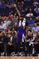 Nov 20, 2013; Phoenix, AZ, USA; Sacramento Kings center DeMarcus Cousins (15) reacts on the bench with teammates in the second half of the game against the Phoenix Suns at US Airways Center. The Kings defeated the Suns 113-106. Mandatory Credit: Jennifer Stewart-USA TODAY Sports