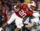 Nov 30, 2013; Madison, WI, USA; Wisconsin Badgers running back James White (20) runs the ball against Penn State Nittany Lions safety Von Walker at Camp Randall Stadium. Penn State defeated Wisconsin 31-24. Mandatory Credit: Mary Langenfeld-USA TODAY Sports
