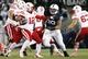 Nov 23, 2013; University Park, PA, USA; Penn State Nittany Lions defensive tackle Austin Johnson (99) attempts to sack Nebraska Cornhuskers quarterback Ron Kellogg III (12) during the third quarter at Beaver Stadium. Nebraska defeated Penn State 23-20 in overtime. Mandatory Credit: Matthew O'Haren-USA TODAY Sports