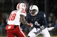 Nov 23, 2013; University Park, PA, USA; Penn State Nittany Lions safety Adrian Amos (4) covers Nebraska Cornhuskers wide receiver Quincy Enunwa (18) during the fourth quarter at Beaver Stadium. Nebraska defeated Penn State 23-20 in overtime. Mandatory Credit: Matthew O'Haren-USA TODAY Sports