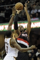 Dec 17, 2013; Cleveland, OH, USA; Portland Trail Blazers power forward LaMarcus Aldridge (12) shoots over Cleveland Cavaliers power forward Tristan Thompson (13) in the second quarter at Quicken Loans Arena. Mandatory Credit: David Richard-USA TODAY Sports