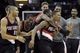 Dec 17, 2013; Cleveland, OH, USA; Portland Trail Blazers point guard Damian Lillard (front right) is swarmed by his teammates after making a game-winning, three-point basket against the Cleveland Cavaliers at Quicken Loans Arena. Mandatory Credit: David Richard-USA TODAY Sports
