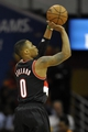 Dec 17, 2013; Cleveland, OH, USA; Portland Trail Blazers point guard Damian Lillard (0) shoots in the third quarter against the Cleveland Cavaliers at Quicken Loans Arena. Mandatory Credit: David Richard-USA TODAY Sports
