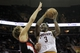 Dec 17, 2013; Cleveland, OH, USA; Cleveland Cavaliers shooting guard Dion Waiters (3) drives against Portland Trail Blazers center Robin Lopez (42) in the fourth quarter at Quicken Loans Arena. Mandatory Credit: David Richard-USA TODAY Sports