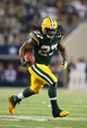 Dec 15, 2013; Arlington, TX, USA; Green Bay Packers running back Eddie Lacy (27) runs with the ball against the Dallas Cowboys at AT&T Stadium. Mandatory Credit: Matthew Emmons-USA TODAY Sports