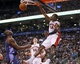 Dec 18, 2013; Toronto, Ontario, CAN; Toronto Raptors forward Patrick Patterson (54) dunks the ball as forward Tyler Hansbrough (50) and Charlotte Bobcats center-forward Bismack Biyombo (0) look on at the Air Canada Centre. Charlotte defeated Toronto 104-102 in overtime. Mandatory Credit: John E. Sokolowski-USA TODAY Sports