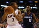 Dec 18, 2013; Toronto, Ontario, CAN; Toronto Raptors guard Kyle Lowry (7) looks to pass as Charlotte Bobcats guard Kemba Walker (15) defends at the Air Canada Centre. Charlotte defeated Toronto 104-102 in overtime. Mandatory Credit: John E. Sokolowski-USA TODAY Sports