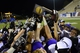Dec 20, 2013; Salem, VA, USA; UW-Whitewater players hold up the championship trophy. UW-Whitewater defeated Mount Union Purple Raiders 52-14 at Salem Stadium. Mandatory Credit: Bob Donnan-USA TODAY Sports