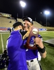Dec 20, 2013; Salem, VA, USA; UW-Whitewater quarterback Matt Behrendt (16) with the MVP trophy hugs wide receiver Joe Worth (9) after the game. UW-Whitewater defeated Mount Union Purple Raiders 52-14 at Salem Stadium. Mandatory Credit: Bob Donnan-USA TODAY Sports