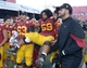 Dec 21, 2013; Las Vegas, NV, USA; Southern California Trojans senior linebacker Kyle Yatabe (59) is carried off the field by guard Giovanni Di Paolo (63) and tackle Nathan Guertler (76) after the Las Vegas Bowl against the Fresno State Bulldogs at Sam Boyd Stadium. USC defeated Fresno State 45-20. Mandatory Credit: Kirby Lee-USA TODAY Sports