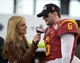 Dec 21, 2013; Las Vegas, NV, USA; ESPN reporter Samantha Ponder (left) interviews Southern California Trojans quarterback and most valuable player Cody Kessler (6) after the Las Vegas Bowl against the Fresno State Bulldogs at Sam Boyd Stadium. USC defeated Fresno State 45-20. Mandatory Credit: Kirby Lee-USA TODAY Sports
