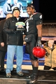 Dec 21, 2013; Boise, ID, USA; San Diego State Aztecs running back Adam Muema (4) receives the MVP award from Frank Muir President and CEO of the Idaho Potato Commission at the conclusion of the Idaho Potato Bowl against the Buffalo Bulls at Bronco Stadium. San Diego defeated Buffalo 49-24. Mandatory Credit: Brian Losness-USA TODAY Sports