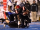 Dec 21, 2013; Boise, ID, USA; San Diego State Aztecs running back Adam Muema (4) is brought down by Buffalo Bulls defensive back Cortney Lester (4) during the second half of the Idaho Potato Bowl at Bronco Stadium.  San Diego defeated Buffalo 49-24. Mandatory Credit: Brian Losness-USA TODAY Sports