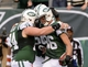 Dec 22, 2013; East Rutherford, NJ, USA; New York Jets wide receiver David Nelson (86) is congratulated by teammates including center Nick Mangold (74) after his second touchdown during the game against the Cleveland Browns at MetLife Stadium. Mandatory Credit: Robert Deutsch-USA TODAY Sports