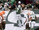 Dec 22, 2013; East Rutherford, NJ, USA; New York Jets quarterback Geno Smith (7) jumps into the stands after a touchdown against the Cleveland Browns in the second half during the game at MetLife Stadium. Mandatory Credit: Robert Deutsch-USA TODAY Sports