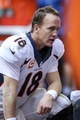 Dec 22, 2013; Houston, TX, USA; Denver Broncos quarterback Peyton Manning (18) sits on the sideline during the fourth quarter against the Houston Texans at Reliant Stadium. The Broncos defeated the Texans 37-13. Mandatory Credit: Troy Taormina-USA TODAY Sports