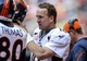 Dec 22, 2013; Houston, TX, USA; Denver Broncos quarterback Peyton Manning (18) walks on the sideline during the fourth quarter against the Houston Texans at Reliant Stadium. The Broncos defeated the Texans 37-13. Mandatory Credit: Troy Taormina-USA TODAY Sports