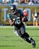 Dec 22, 2013; Jacksonville, FL, USA; Jacksonville Jaguars wide receiver Denard Robinson (16) runs the ball during the game against the Tennessee Titans at EverBank Field. Mandatory Credit: Melina Vastola-USA TODAY Sports