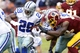 Dec 22, 2013; Landover, MD, USA; Dallas Cowboys running back DeMarco Murray (29) carries the ball as Washington Redskins outside linebacker Brian Orakpo (98) attempts to make the tackle in the fourth quarter at FedEx Field. The Cowboys won 24-23. Mandatory Credit: Geoff Burke-USA TODAY Sports