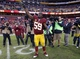 Dec 22, 2013; Landover, MD, USA; Washington Redskins inside linebacker London Fletcher (59) waves to fans while leaving the field after the Redskins' game against the Dallas Cowboys at FedEx Field. The Cowboys won 24-23. Mandatory Credit: Geoff Burke-USA TODAY Sports