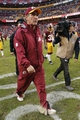 Dec 22, 2013; Landover, MD, USA; Washington Redskins head coach Mike Shanahan walks off the field after the Redskins' game against the Dallas Cowboys at FedEx Field. The Cowboys won 24-23. Mandatory Credit: Geoff Burke-USA TODAY Sports