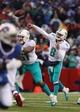 Dec 22, 2013; Orchard Park, NY, USA; Miami Dolphins quarterback Matt Moore (8) thaws a pass during the second half against the Buffalo Bills at Ralph Wilson Stadium. Buffalo beats Miami 19-0.  Mandatory Credit: Timothy T. Ludwig-USA TODAY Sports