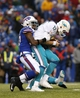 Dec 22, 2013; Orchard Park, NY, USA; Buffalo Bills defensive back Nickell Robey (37) sacks Miami Dolphins quarterback Ryan Tannehill (17) during the second half at Ralph Wilson Stadium. Bills beat the Dolphins 19-0. Mandatory Credit: Kevin Hoffman-USA TODAY Sports