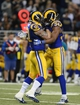 Dec 22, 2013; St. Louis, MO, USA; St. Louis Rams defensive end Robert Quinn (94) celebrates with defensive end Chris Long (91) after sacking Tampa Bay Buccaneers quarterback Mike Glennon (not pictured) during the second half at the Edward Jones Dome. The Rams defeated the Buccaneers 23-13. Mandatory Credit: Jeff Curry-USA TODAY Sports