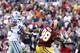 Dec 22, 2013; Landover, MD, USA; Washington Redskins wide receiver Pierre Garcon (88) and Dallas Cowboys cornerback Orlando Scandrick (32) reach for the ball in the fourth quarter at FedEx Field. The Cowboys won 24-23. Mandatory Credit: Geoff Burke-USA TODAY Sports