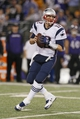 Dec 22, 2013; Baltimore, MD, USA; New England Patriots quarterback Tom Brady (12) drops back to pass against the Baltimore Ravens at M&T Bank Stadium. Mandatory Credit: Mitch Stringer-USA TODAY Sports